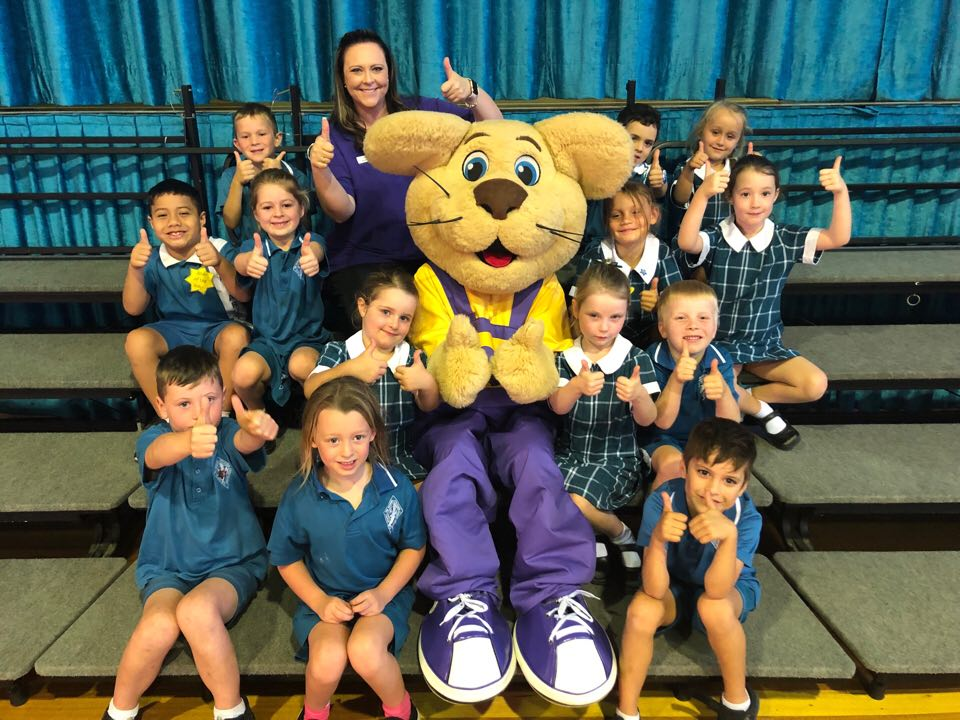 Ditto the lion cub mascot with school children